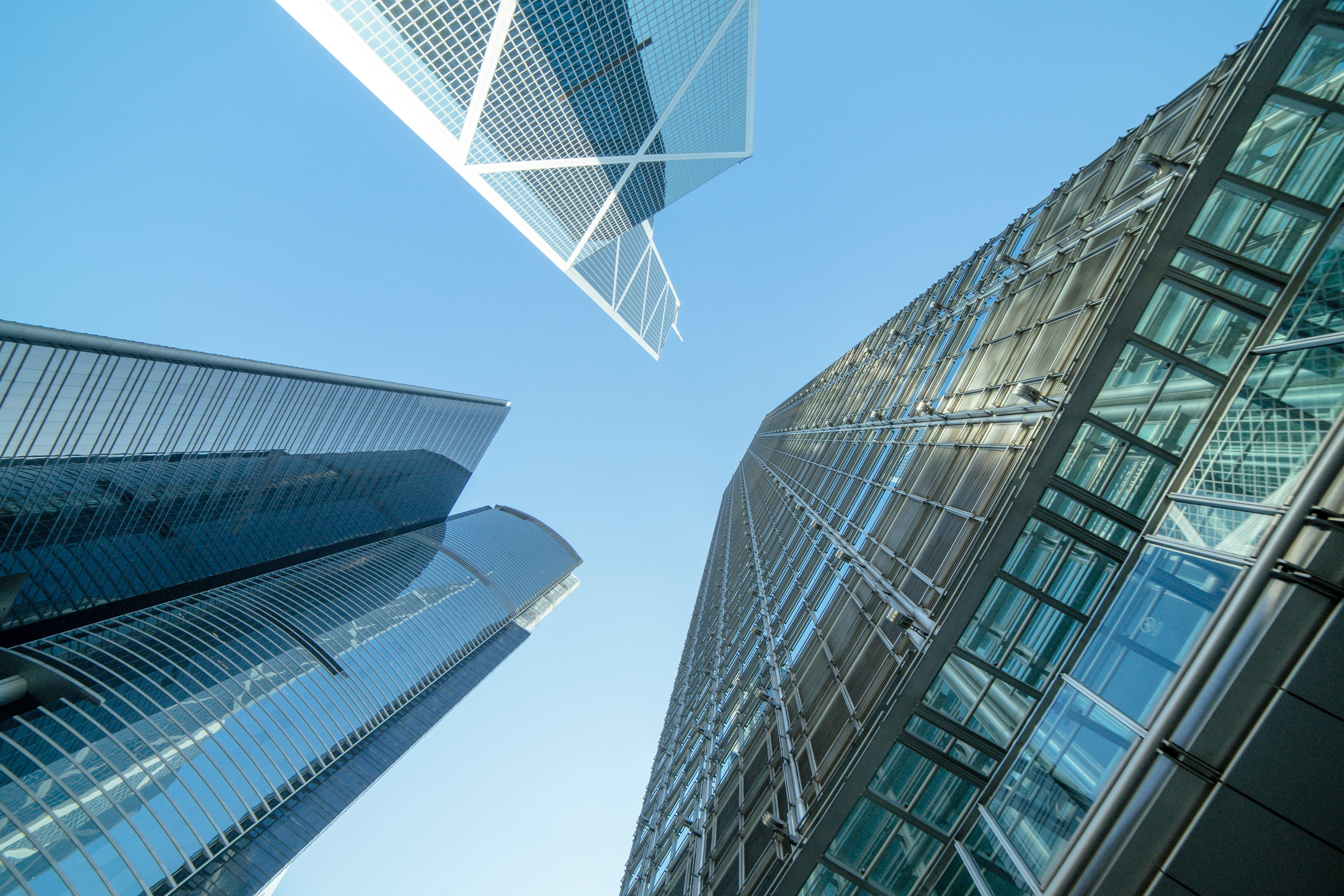 low-angle-photography-of-buildings-under-blue-and-white-sky-998499